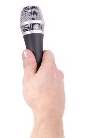 hand holding out a microphone ready for recording photo