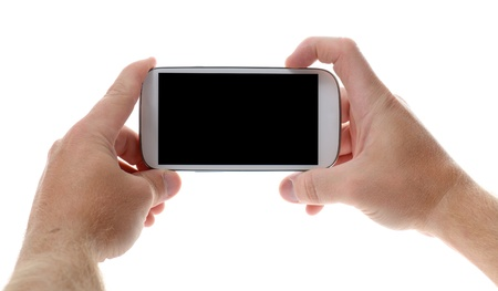 snapping fingers: Taking a picture with a mobile smart phone with copy space isolated on white background
