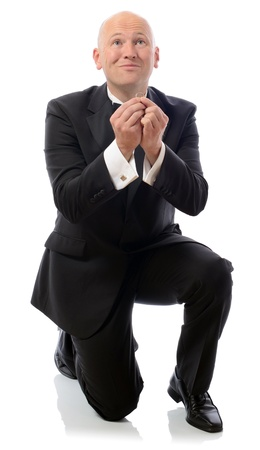 bended: Man on bended knee proposing with a ring isolated in white background