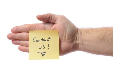 Hand woth post it note saying contact us isolated on white photo