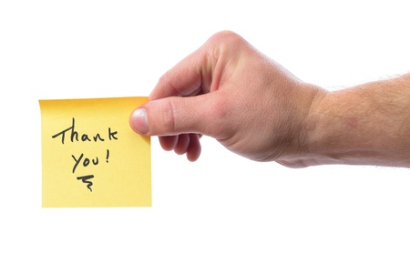 post it note saying thank you isolated on white photo