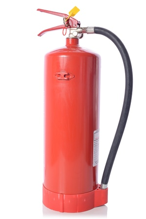 A red fire extinguisher with inspection label isolated on white background Stock Photo - 17757221