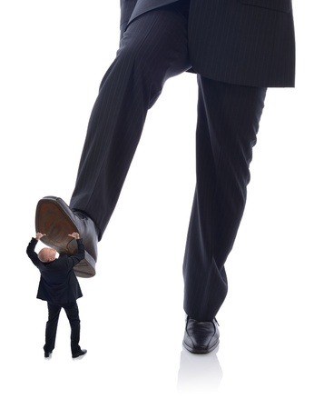 going down: manager Buisnessman in suit stepping on employee isolated on white Stock Photo