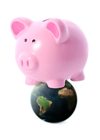 World banking concept, piggy bank on a globe isolated on white photo