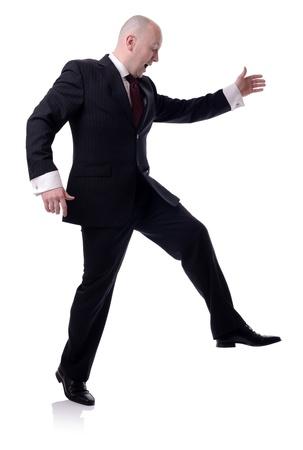 running pants: businessman large steps isolated on white background Stock Photo