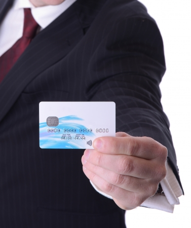 man holding out a credit debit card with copy space isolated on white background photo