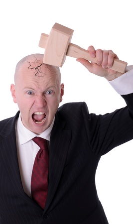 going crazy: businessman under pressure smashing head isolated on white
