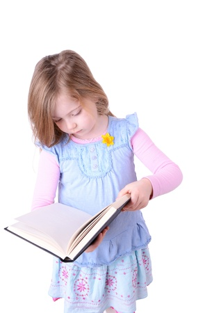 aciculum: little girl reading a big book isolated on white background