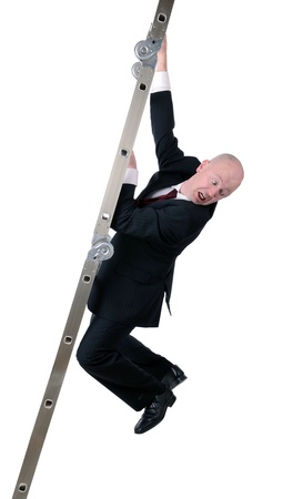 directly below: businessman hanging on to ladder isolated on white background