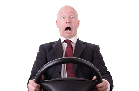 driving: business shock isolated on white businessman with steering wheel Stock Photo