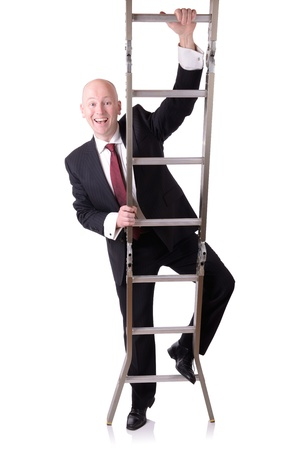 climbing ladder: businessman starting on the ladder of success isolated on white