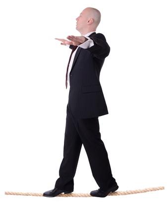 businessman walking the line isolated on white background photo