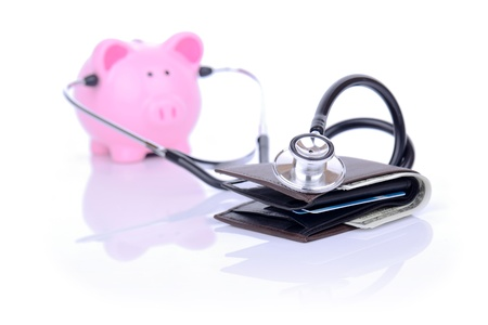 alternative medicine: financial check up piggy bank and wallet concept focus on the wallet Stock Photo