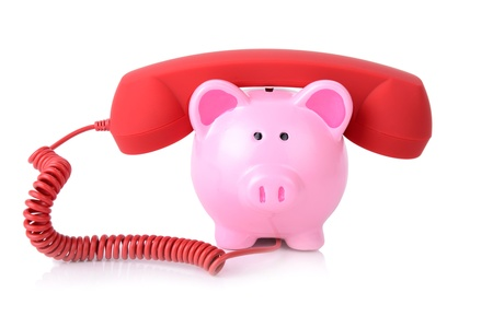 call the bank for support or telephone banking concept piggy bank with red phone reciver isoalted on white