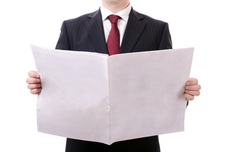 adult magazines: businessman holding a blank news paper isolated on white
