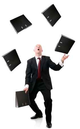 Concept of multi tasking in business, man juggling files isolated on white background.