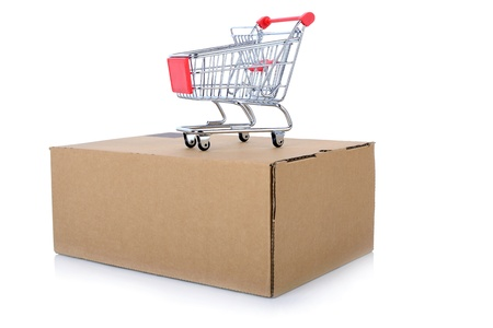 concept of internet shopping of a push cart isolated on top of a package photo