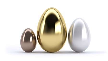 three eggs gold silver and bronze on white background. concept of award or level of service. photo
