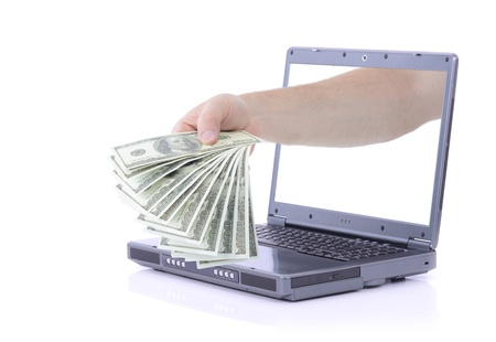 grey laptop  giving out money isolated on white background photo