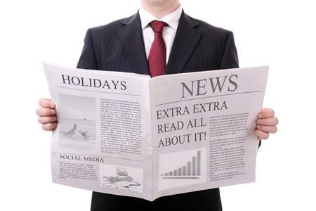 newspaper reading: businessman holding a blank news paper isolated on white