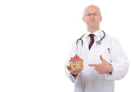 concept of house check up or house doctor isolated on white background photo