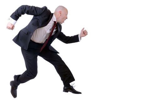 blurr: businessman running isolated on white background with slight motion blurr