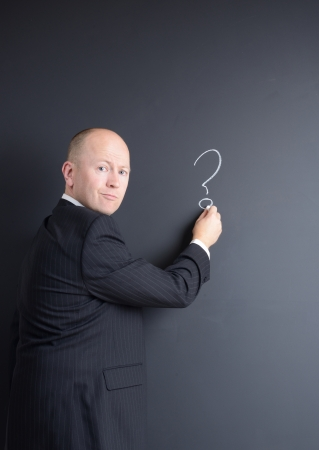 concept the question and answer session businessman in front of chalk board photo