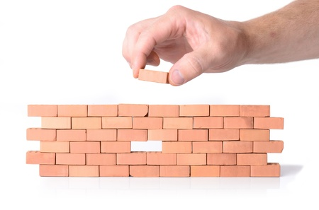 bric: Concept for skill or building a team working together, hole in the wall.
