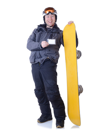 Man showing a ski pass copy space while holding his snowboard isolated on white photo