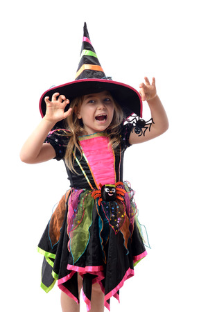 halloween costume: Little girl dressed up as a witch isolated on white