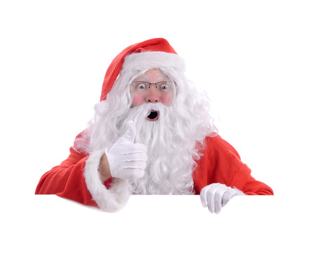 Santa poping up behind white copy space with a thumbs up you have been good, isolated on a white background photo