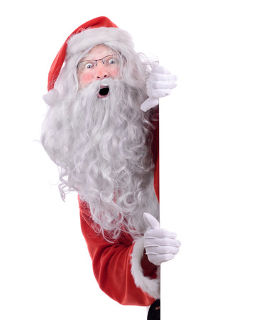 Santa claus peeking from behind a side frame isolated on white photo