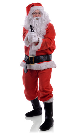 pointing gun: A bad santa with a gun pointing at camera isolated on a white background.