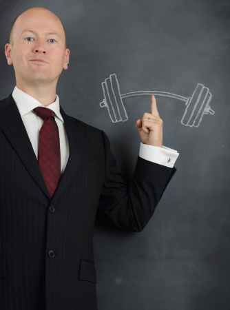 concept of businessman power with ease Stock Photo