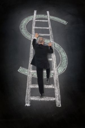 businessman climbing a Dollar sign incorporating a ladder into the symbol drawn in chalk  photo