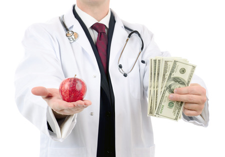 doctor giving dollars: doctor giving haelth advise for money isolated on a white background Stock Photo
