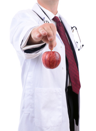 a doctor handing out a red apple advise of healthy eating Stock Photo - 23080330