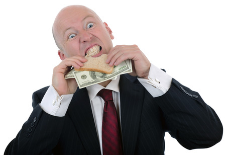 decadence: businessman eating a money sandwich  isolate don a white background Stock Photo