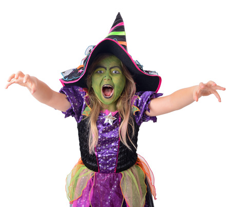 little green witch casting a spell,isolated on a white background photo