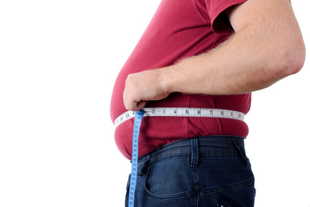 side profile of an over weight man measuring stomach Stock Photo - 23135990