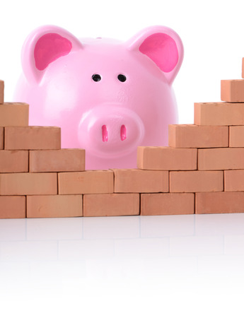 breaking down: concept piggy bank breaking down the walls of finance Stock Photo