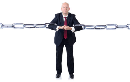A powerfull businessman holding chains together isolated on a white background