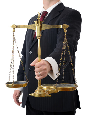 A laywer holding the scales of justice isolated on a white background Standard-Bild