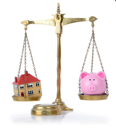 housing problems: house and bank in balance concept for balance of finances