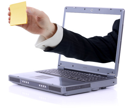 powerbook: grey laptop with yellow stick note reminder with  copy space clipping path isolated on white Stock Photo