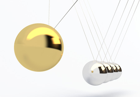 gravitational: One gold leader has power over silver balls  Stock Photo