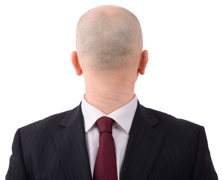 Going in the wrong direction? man with head on backwards isolated on a white background Stock Photo - 24865954