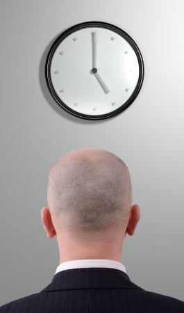 Businessman watching the clock photo