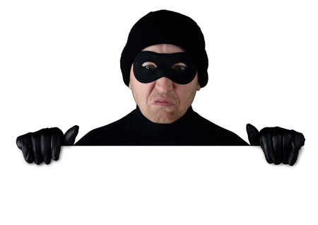 eye mask: Thief peering over the top of isolated white copy space Stock Photo