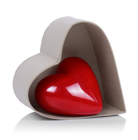 A heart within a heart shaped box isolated on a white background photo